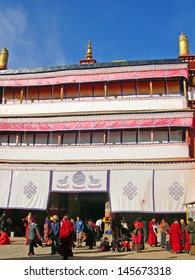 LHASA, TIBET-NOVEMBER 14: pilgrims and monk entering the Ramoche Temple.  The temple is considered the most important temple in Lhasa after the Jokhang Temple. November 14, 2004 Lhasa, Tibet