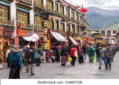 LHASA/CHINA - SEPTEMBER 5, 2014: People walking at the Barkhor street in Lhasa, Tibet, China.