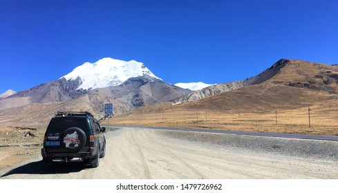 Lhatse, Tibet / China - October 22 2016: Driving through Tibet is an increasingly popular adventure holiday for Chinese and overseas visitors to Tibet