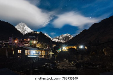 Lho-Nepal-December 2017 : Lho village at night. Manaslu circuit trek with a mount Manaslu in background.