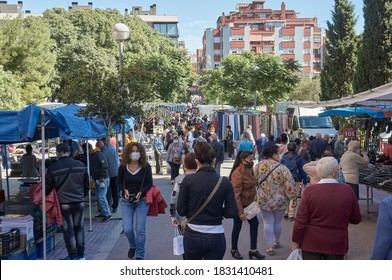 L'Hospitalet de Llobregat, Spain - October 11th 2020: Editorial photo of a Hospitalet de llobregat street market during the covid-19 pandemic where you can see that the safety distance is not met.