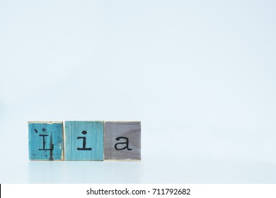 Lia. Wooden letters on white background