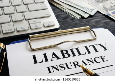 Liability insurance agreement on the desk.