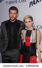 "Liam Hemsworth and Miley Cyrus at the ""Paranoia"" US Premiere, Directors Guild of America, Los Angeles, CA 08-08-13"