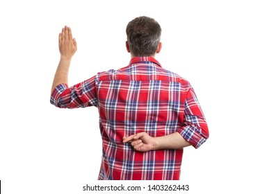Liar man holding crossed fingers behind back and palm up as fake oath gesture isolated on white background