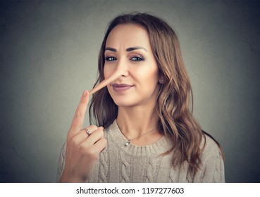 A liar sly woman with long nose