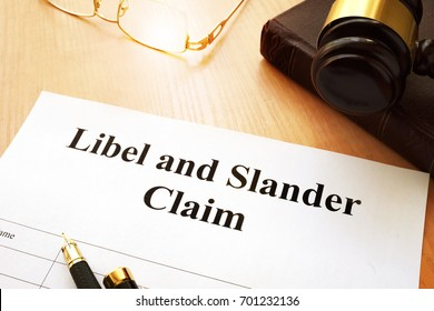 Libel and Slander Claims on a desk.