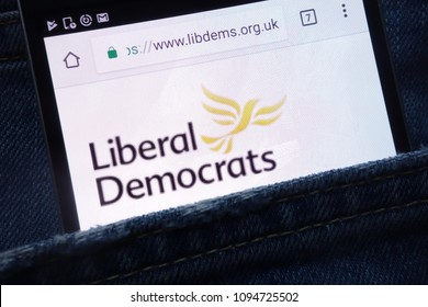 The Liberal Democrats political party website displayed on smartphone hidden in jeans pocket