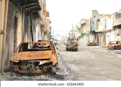 The liberated area in Iraq, the war on the Islamic state. Burned cars.