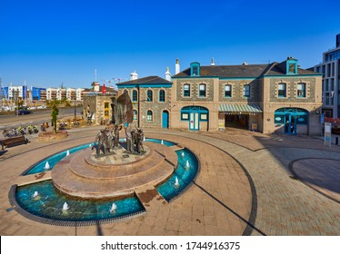 Liberation Square, on a early sunny morning. St Helier is the capital of Jersey and a financial centre with shops, restaurants and cultural interest St Helier, Jersey, Channel Islands 26 May 2020