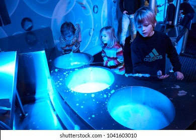 Liberec, Czech Republic - February 21, 2016: People and devices in Science Centre iQLANDIA. Modern science center with a planetarium and hundreds of original interactive exhibits.