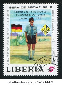LIBERIA - CIRCA 1971: stamp printed by Liberia, shows Boy scout, emblem and flag of Germany, circa 1971