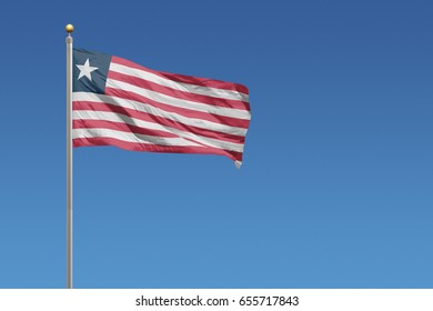Liberia flag in front of a clear blue sky