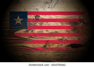 Liberia flag painted on dark_gold_and_brown_wood texture background