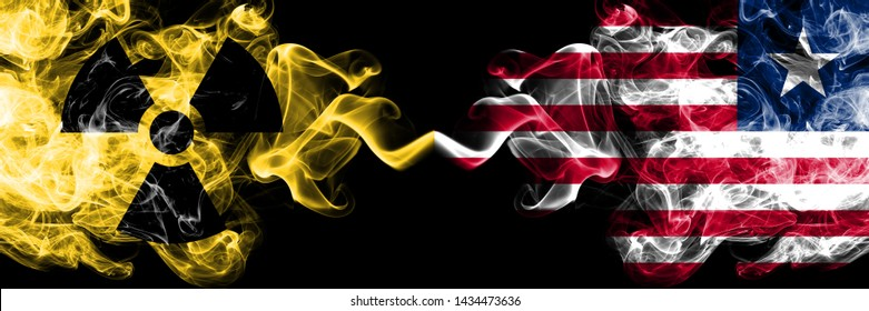 Liberia, Liberian vs nuclear smoky mystic flags placed side by side. Thick colored silky smokes combination of Liberia, Liberian flag and radioactive sign.
