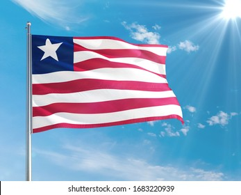 Liberia national flag waving in the wind against deep blue sky. High quality fabric. International relations concept.
