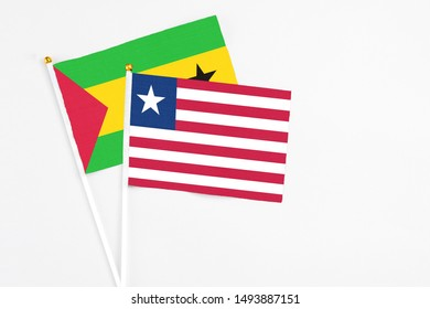 Liberia and Sao Tome And Principe stick flags on white background. High quality fabric, miniature national flag. Peaceful global concept.White floor for copy space.