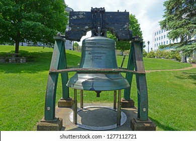 Liberty Bell in front of Maine State House. This building is the state capitol of the State of Maine in Augusta, Maine, USA. Maine State House was built in 1832 with Greek Revival style.