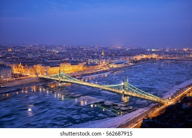 Liberty bridge danube river winter in Budapest night