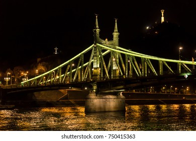 Liberty Bridge at Night from the Danube River in Budapest Hungary