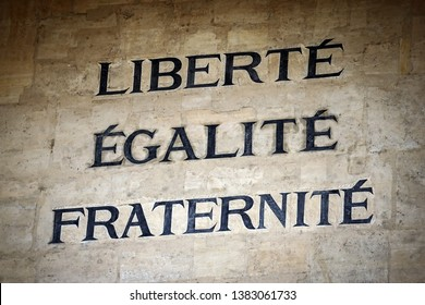Liberty, Equality and Fraternity words on the facade of the Law University building in Paris, the motto of the French Revolution