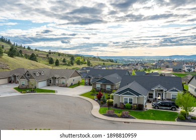 Liberty Lake, Washington, USA - January 15 2021: View from a hilltop in Liberty Lake, Washington, of  a newer subdivision of homes with the cities  of Spokane and Spokane Valley. in the distance.