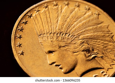 Liberty motto. Numismatic at work shows some gold coins. Detailed view of an Indian gold coins collection. Ancient coins of the United States of America.