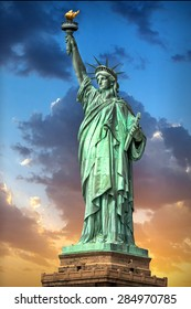 Liberty Statue in Manhattan New York at sunset, USA