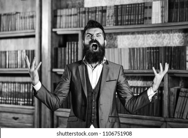 librarian in the library. Going crazy, mad and insane, wild, stress and agression, shame, hysteria, accuse, blame, fault, rage responsibility uncontrollable agressive angry evil rude man in library