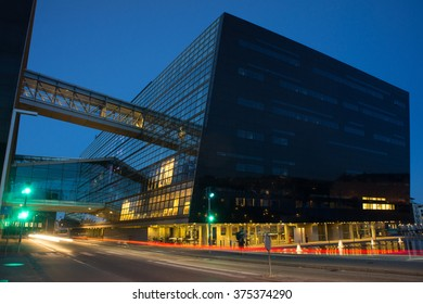 """Library building on the harbor front in Copenhagen at night. Known as the """"Black Diamond"""" library building in Copenhagen, Denmark. Night view of Copenhagen architecture. Modern architecture library."""