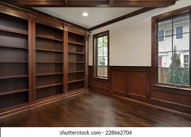 Library in new construction home with ceiling beam