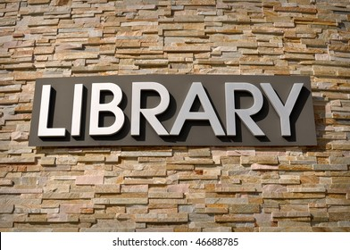 Library Sign on Stone Wall