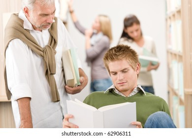Library - student with mature professor at high school with book