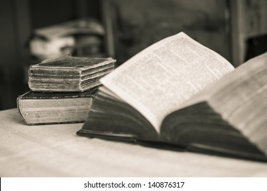 Library - Three old Bibles on the table