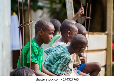LIBREVILLE, GABON - MAR 6, 2013: Unidentified Gabonese children play outside in the yard in Gabon, Mar 6, 2013. People of Gabon suffer of poverty due to the unstable economical situation