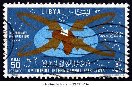 LIBYA - CIRCA 1965: a stamp printed in Libya shows Map of Africa with Libya, Fair Emblem, 4th International Fair, Tripoli, circa 1965