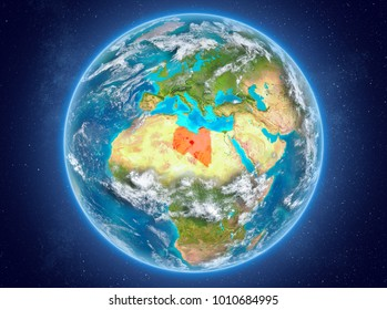 Libya in red on model of planet Earth with clouds and atmosphere in space. 3D illustration. Elements of this image furnished by NASA.