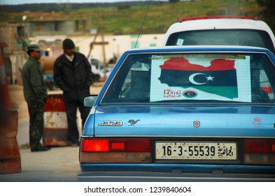 Libyan has placed an anti-government poster on the rear window of his car. Protest against the regime of Muammar Gaddafi. The Arab Spring begins. Benghazi, Libya, April 6, 2011.