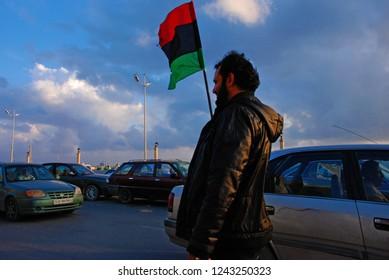 Libyan protests against the regime of Muammar Gaddafi. The flag is a symbol of the Arab Spring in Libya. April 6, 2011, Benghazi, Libya.