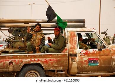 Libyan rebels travel to a battle line where they will fight Colonel Muammar Gaddafi's army. Ajdabiya, Libya, April 7, 2011