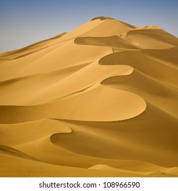 Libyan Sahara. Dunes. Sand structure at sunset.