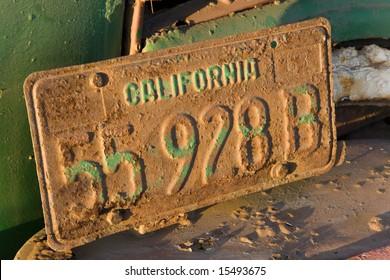 License plate on an old truck in an artichoke field near Santa Cruz, California.