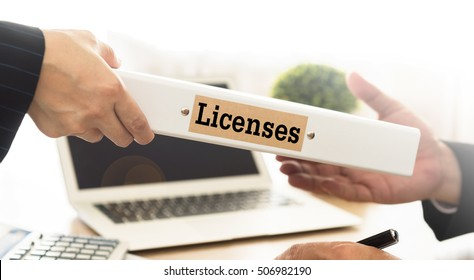 Licenses Concept. Staff send licenses folder to business people.