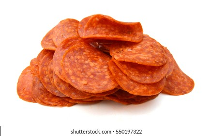 lices of pepperoni on white background