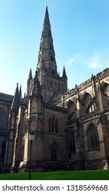 Lichfield Cathedral tower. Gothic architecture with arched windows.
