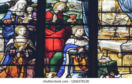 Lichfield, England - Oct 15, 2018: Interiors of Lichfield Cathedral - Stained Glass in Lady Chapel N4 - Donors, their patron saints and coats of arms Close up A