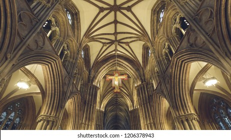 Lichfield, England - Oct 15, 2018: Interiors of Lichfield Cathedral - Icon - Hanging Cross and Ceiling in Nave