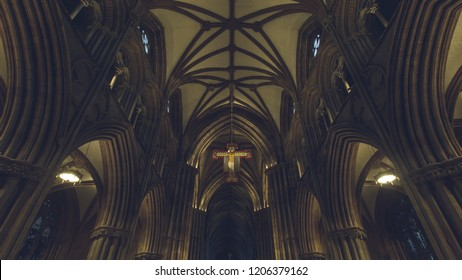 Lichfield, England - Oct 15, 2018: Interiors of Lichfield Cathedral - Icon - Cross hanging from ceiling