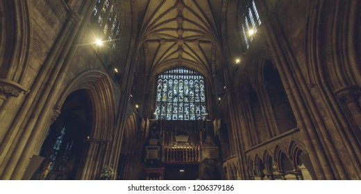 Lichfield, England - Oct 15, 2018: Interiors of Lichfield Cathedral - South Transept Stained Glass and Ceiling