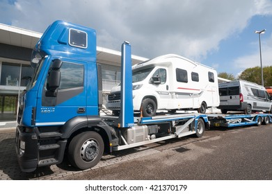 LICHTENBUSCH, GERMANY - MAY 3, 2016: Truck transporter carrying RVs at the public parking place at the truck stop at Lichtenbusch. RV like these are bought and used in Europe in increasing number.
